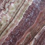 Naturstein, Weichgestein, rot-beige wilde Textur